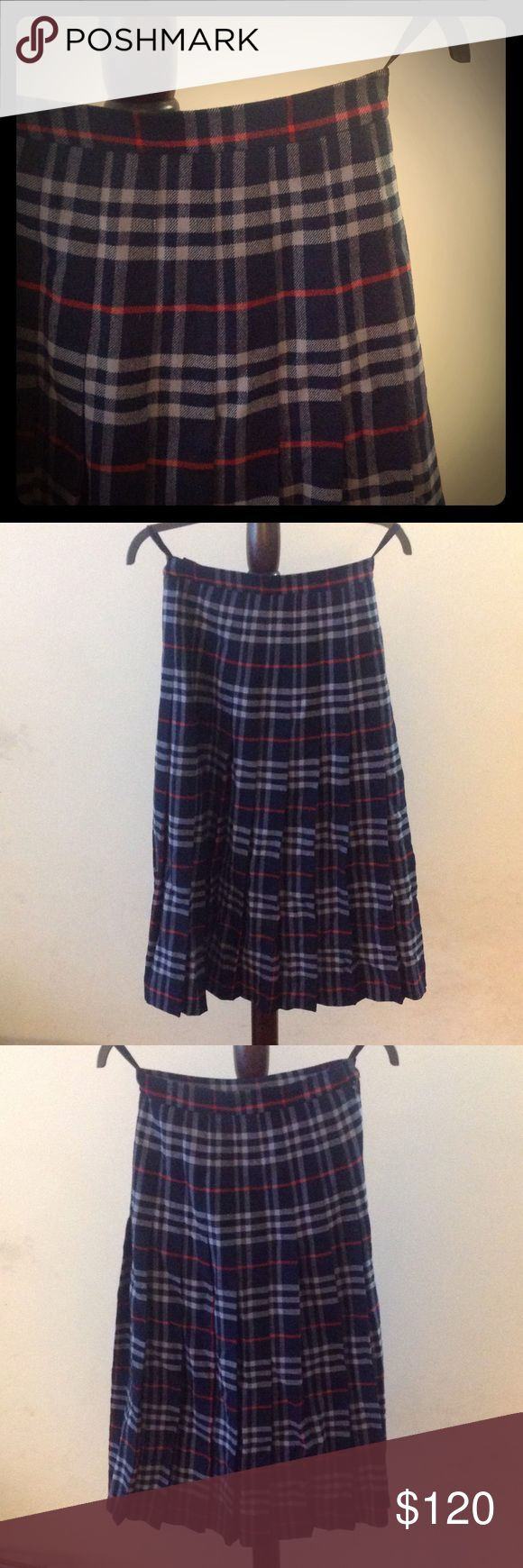 Authentic 1980s Vintage Wool Burberry Skirt Vintage pleated navy plaid wool Burberry skirt. I believe from the 1980s. Given to me by my mother. Excellent condition. Only worn a few times. Size 2 US. More information on the vintage label can be found here: http://vintagefashionguild.org/label-resource/burberrys/ Burberry Skirts Midi