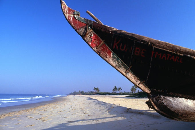 Traditional long-boat on Benaulim beach in Goa.