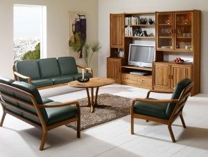The photo shows: 1260 easy chair w/leather 40505 Green 1260/2 2-seater sofa w/leather 40505 Green 9257 coffee table 9256E end table VK rosenborg wall unit combination w/plain doors