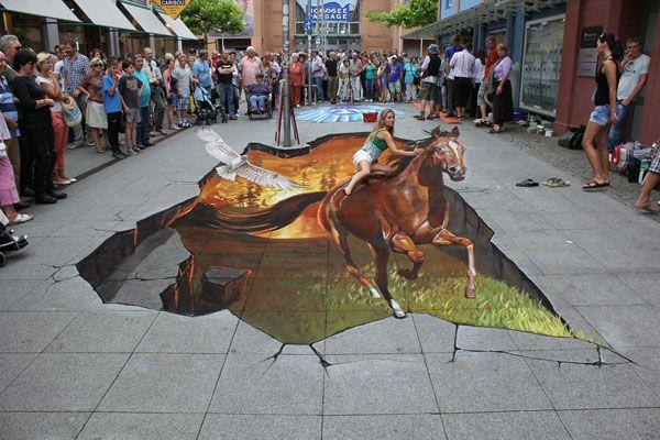 3D Sidewalk Art  Using chalk and pigment, Germany-based artist Nikolaj Arndt creates magnificent 3D illustrations on the pavement of city streets. Just like the 3D Sidewalk Art of Edgar Müller.