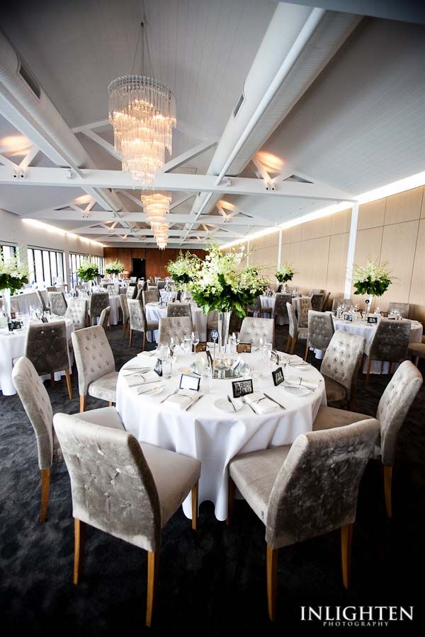 Simple and elegant wedding reception table with centre floral decorations enhancing the quality and space for a wedding reception.