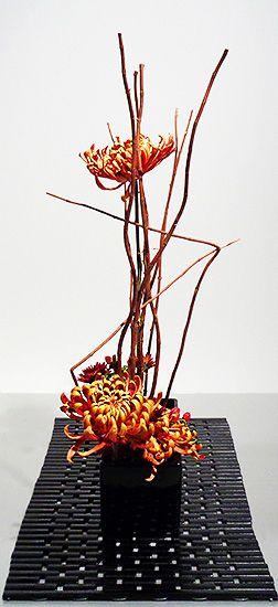Art Loop Ikebana Exhibition 10-2-15 By Soraya Title: Autumn Path - Straight Ahead Theme: Composition of Straight Lines Materials: St. John's Wort Chrysanthemum