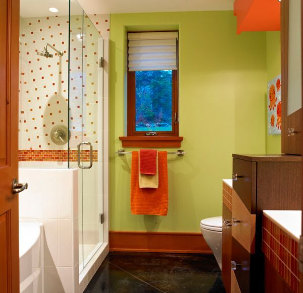 Colorful and stylish kids bathroom with accents of natural wood
