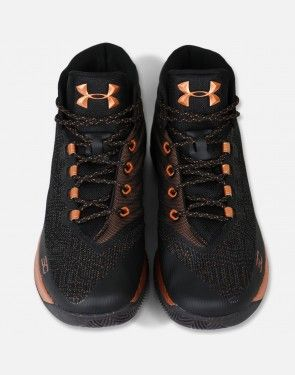 """The shoes are dressed in a black based upper with copper detailing all throughout- Under Armour branding comes in copper on the outside of the tongue. The Steph Curry """"SC"""" mini logo also comes in copper on the lateral side adjacent to the toe box. The midsole is also two toned ( copper color near the forefoot and black from the heel to the mid foot). The eyelets are also covered in copper and will house round black laces with copper speckles. The Under Armour Curry 3 'Brass Band' (B..."""