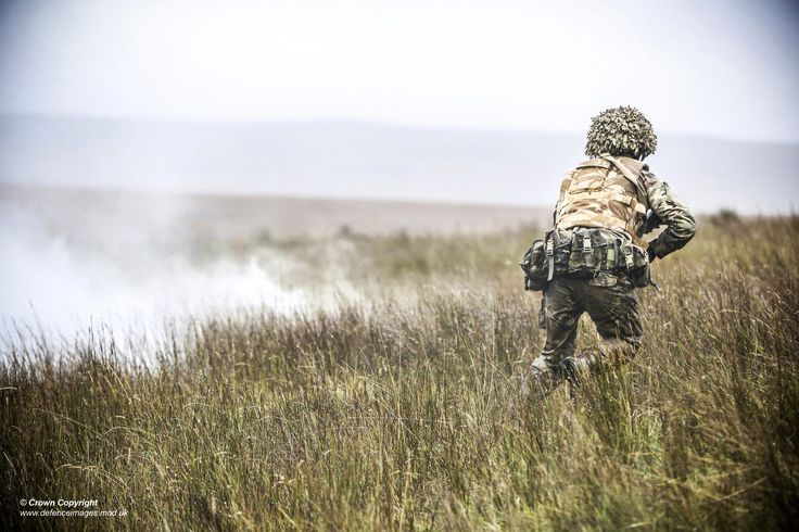 RAF Regiment closing on the enemy flanked by smoke | by Defence Images