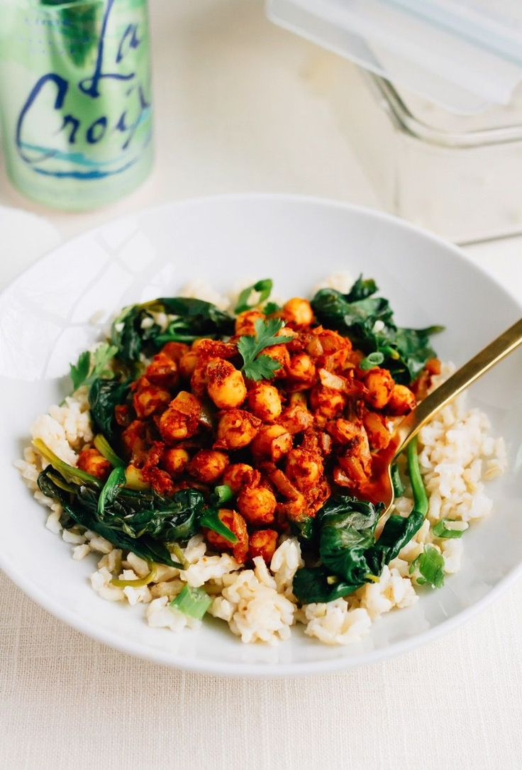 These vegan curried chickpea bowls make meal prepping for the week a breeze. The chickpeas are paired with garlicky spinach and brown rice for an easy meal that's absolutely delicious and filling.