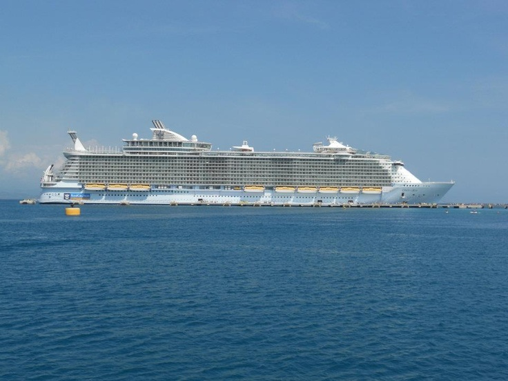 My OASIS cruise ship sitting on RCI private island beach in the Caribbean