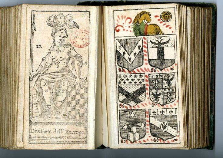 """Tarot pack: Geography and Heraldry: complete pack of 62 playing-cards for the game of tarocchino, giving instruction in both heraldry and geography; bound (at the British Museum) as a small book Hand-coloured woodcut, etching Backs woodcut with a seated female figure with a feathered headdress and spear, her left hand resting on an upright chequer board, lettered """"Divisione dell'Europa""""; printed in black. 1725"""