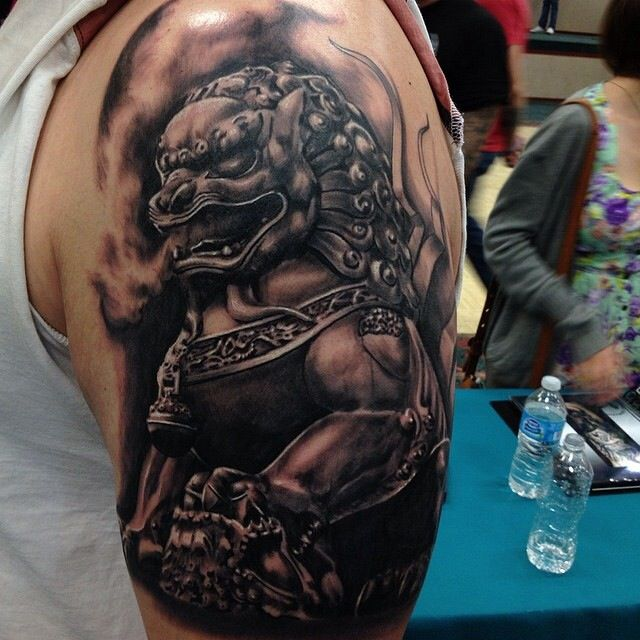 Arm tattoo. Chinese lion statue. By Pete Terranova.