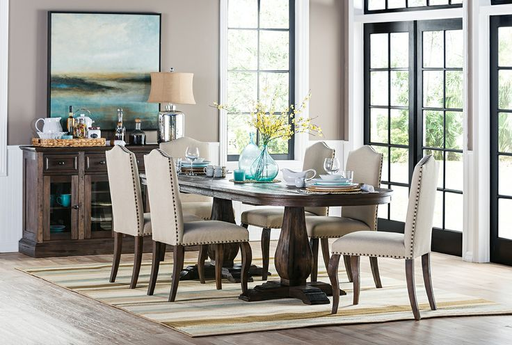 LOVE this look from LivingSpaces We have the dining table but did mix n match chairs and a bench from Living Spaces The hutch is a beautiful p