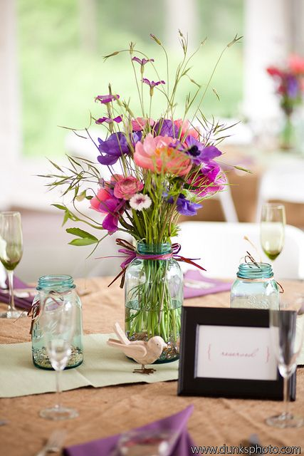 May centerpiece designed in a vintage blue mason jar by Local Color Flowers filled with locally grown anemones, peonies, sweet peas, ranunculus and herbs.