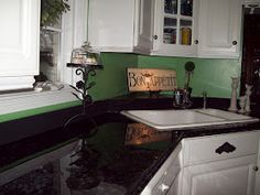 Refinish countertop for about $100. Rustoleum flat black paint, silver metallic paint, Martha Stewart black onyx glitter, envirotex and sea sponge