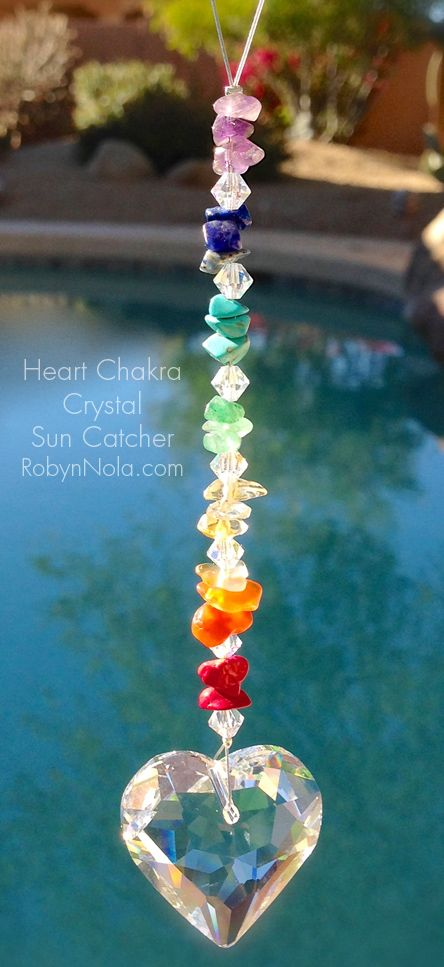 Heart Chakra crystal sun catcher. Hearts and rainbows are reminders of hope, love and joy.