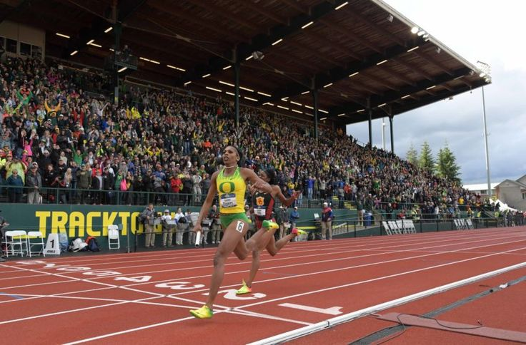 Jun 10, 2017; Eugene, OR, USA; Raeven Rogers of Oregon defeats Kendall Ellis of Southern California on the anchor of the women's 4 x 400m relay, collegiate record 3:23:13 to 3:23.35, to clinch the team title during the NCAA Track and Field Championships at Hayward Field. Mandatory Credit: Kirby Lee-USA TODAY Sports