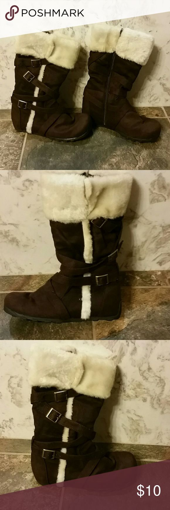 Brown boots with faux fur These are brown boots with faux fur accents. They have zippers which are intact and working. Lightly worn. The boots are a girls size 4, but I was able to wear them and I am a woman's shoe size 6. Shoes Boots
