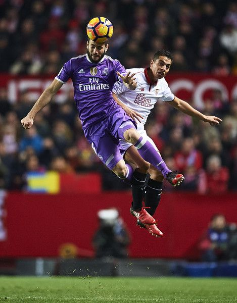 Nacho Fernandez Photos Photos - Nacho Fernandez of Real Madrid CF (L) competes for the ball with Wissam Ben Yedder of Sevilla FC (R) during the La Liga match between Sevilla FC and Real Madrid CF at Estadio Ramon Sanchez Pizjuan on January 15, 2017 in Seville, Spain. - Sevilla FC v Real Madrid CF - La Liga
