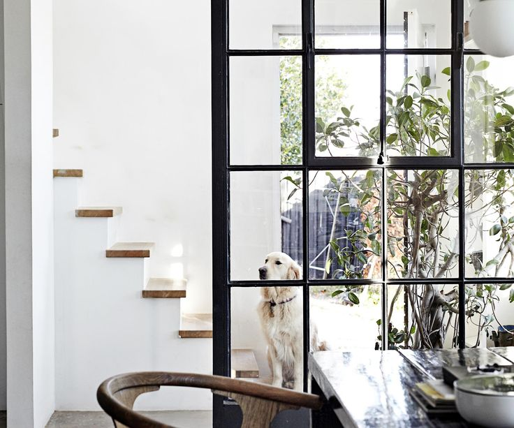 A creative couple convert a 1920s cottage in the countryside into a spacious family home with a raw industrial vibe.