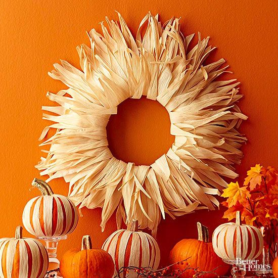Rim a wreath with cornhusks to mimic the golden autumn sun. You'll need a flat wire wreath form and a stash of dried cornhusks. Starting on the outermost ring of the wreath form, spread hot glue on the bottom half of the husk and wrap it around the wreath from back to front. Move inward on the wreath, folding the husks over the previous layer.