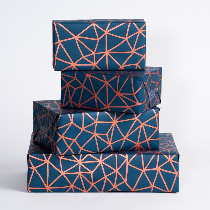 Metallic copper ink on navy blue wrapping paper.