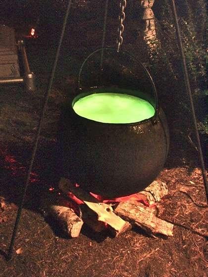 Halloween Full-size Bubbling Cauldron Prop on Instructables.  Paper mache pot