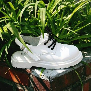 [Oxford Sandals] A pair of #oxfords design #sandals, #shoes featuring buckled ankle straps. #whiteshoes #koreanshoes #shoestore
