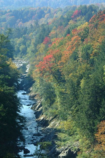 Quechee Gorge - [ Notice the 2 tiny people near the bottom of the pic standing on a rock. The gorge is even deeper and steeper than it looks here. (It's acrophobia inducing, in fact.) Quechee Gorge is near White River Junction VT at the NH border. - Beautiful - PSC ]