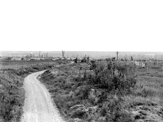 The original Australian War Memorial caption for this photograph reads - 'An unidentified battlefield cemetery outside Dernancourt, France, July 1919'. However, given the location it is almost certainly Dernancourt Communal Cemetery Extension as it looked before the original wooden crosses were replaced by permanent headstones.