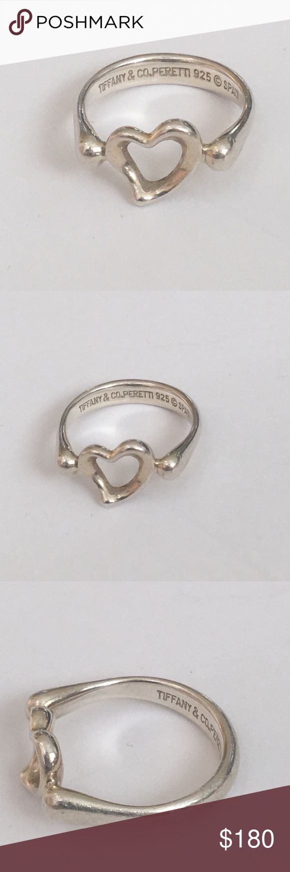 Tiffany Elsa Peretti Heart Ring Mini - Size 4 1/2 This is nothing take Tiffany ring, designed by Elsa Perretti. It is an open heart sterling silver ring. It's a size 4 1/2 and can be size by a jeweler, but it will cut into the Hallmark if you try to make it bigger. The ring is hallmark Tiffany and Company Elsa Perretti & Spain. It is currently available on Tiffany's website for 225. Tiffany & Co. Jewelry Rings