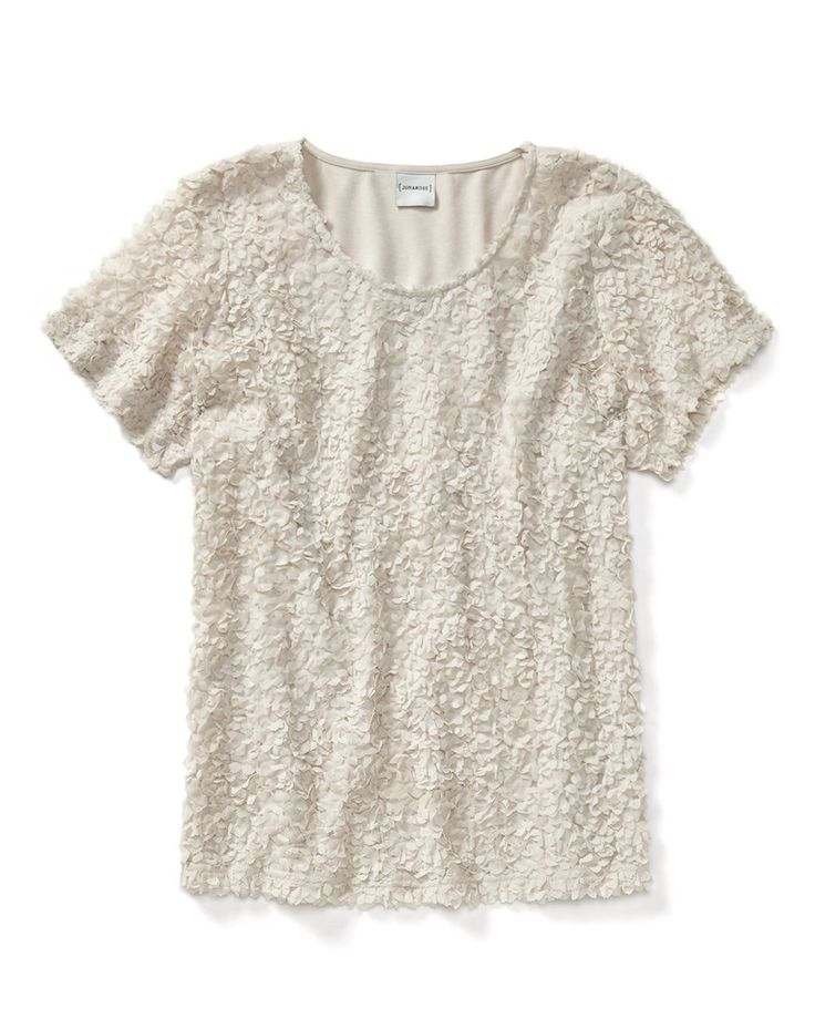 A soft and sweet style for summer, this plus-size short sleeve top from Junarose features a trendy textured feel, rounded neck and flattering shaped fit. Team it with a short for a stylish casual look!