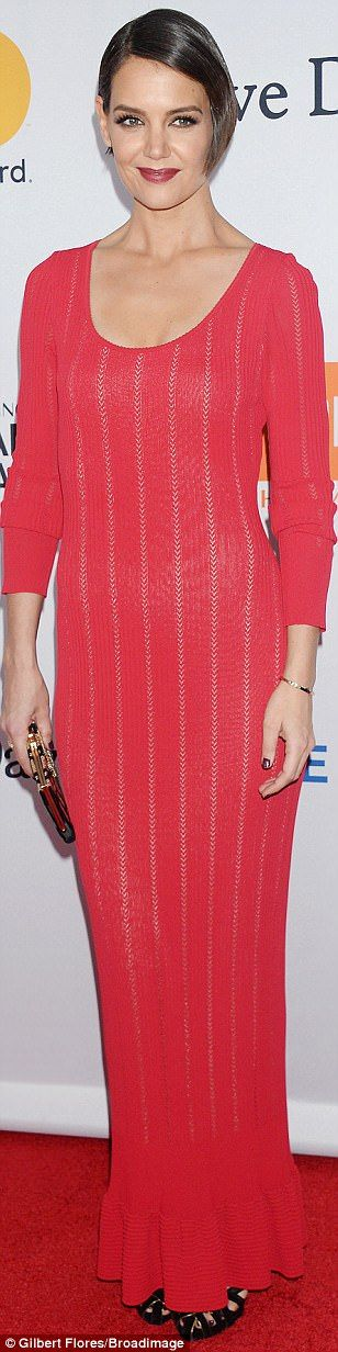 Hello, gorgeous: Katie Holmes went for a simple look, betraying only the slightest hint of cleavage in a full-sleeved coral gown with pale pink stripes running down it