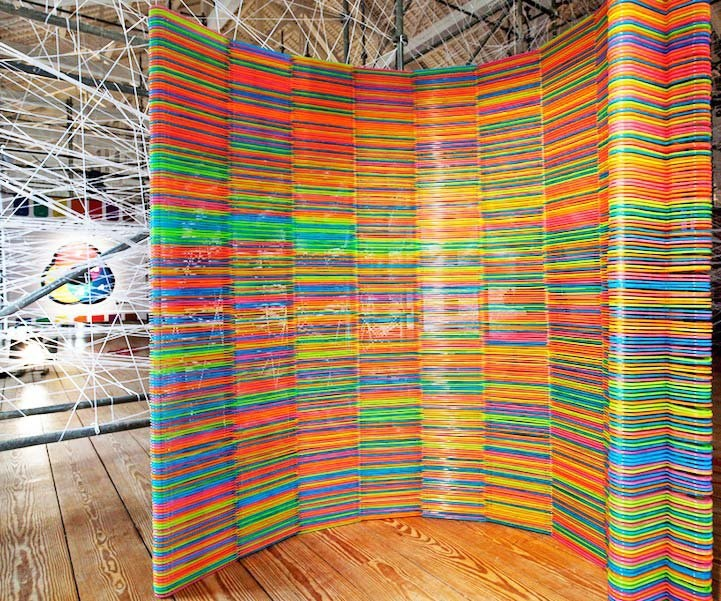 Diogo Agular and Teresa Otta's technicolor Chromatic Screen for the 2012 Oporto Show, constructed from Ikea hangers destined for the landfill.