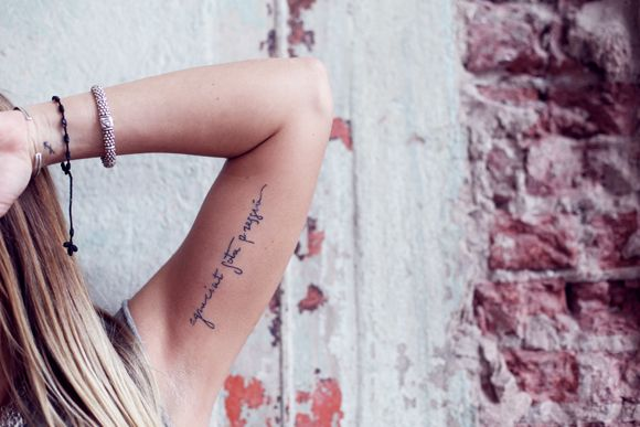 """'Grace under pressure' is something my mom has told me since I was a little girl. My tattoo is Catalan because I am madly in love with the city, Barcelona."""