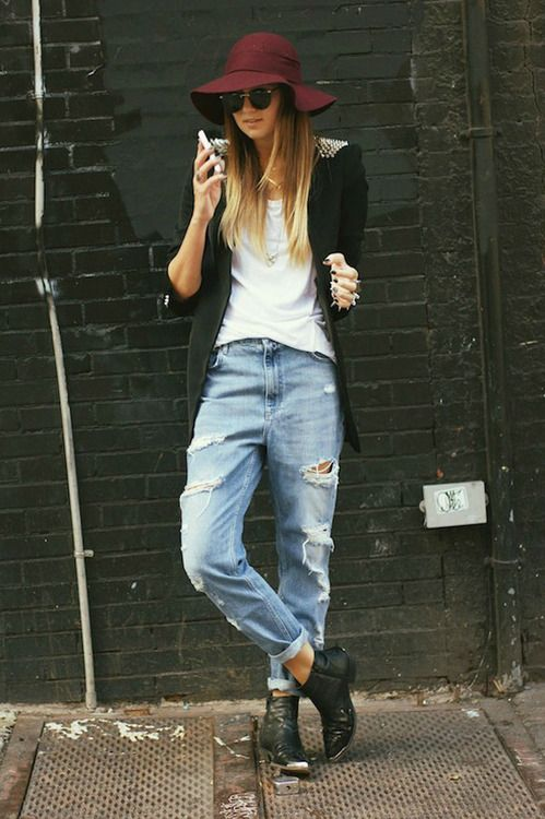 Spiked shoulders on jacket, white tee, ripped boyfriend jeans and plum hat