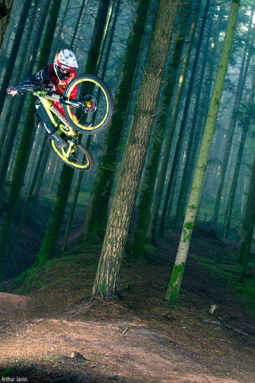 ♂ Adventure bike rider in the deep green woods.