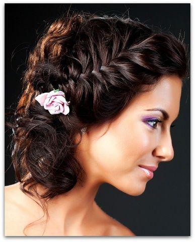 wedding hairdo. long curls down the side.