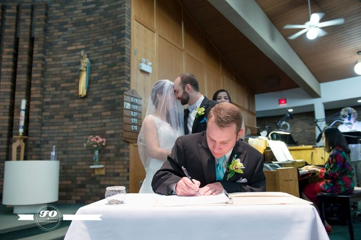 Love how much this couple is so in love that they had a special moment during the marriage register signing, they were completely oblivious to everyone else. Edmonton wedding photographers. Nanette & Francois' Paris, Lego and Teal wedding; Image by FO Photography.