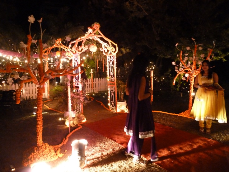 The Sangeet. The first party! This is the entrance to the open air party. Beautiful orange Marigold heads decorating the trees and everything done with huge style.