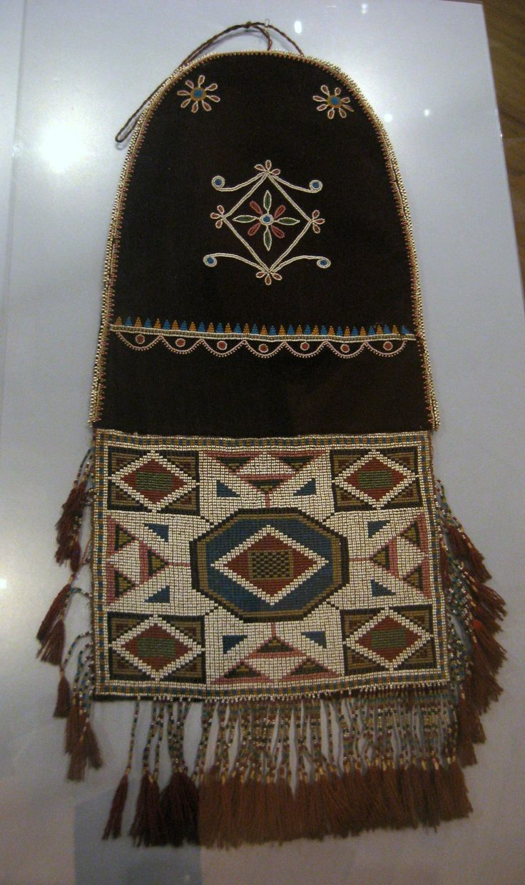 """1846 Cree-Métis (First Nations) Bag at the Royal Ontario Museum, Toronto - From the curators' comments: """"Bags with an extending beadwork panel appeared among Subarctic and Great Lakes bag types around 1800....New materials, such as glass beads and wool broadcloth, were incorporated into the bags after such materials became available through non-Native trade in the early nineteenth century."""""""