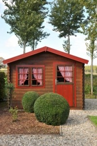 Chalet type Chic Shed complete with gingham curtains.