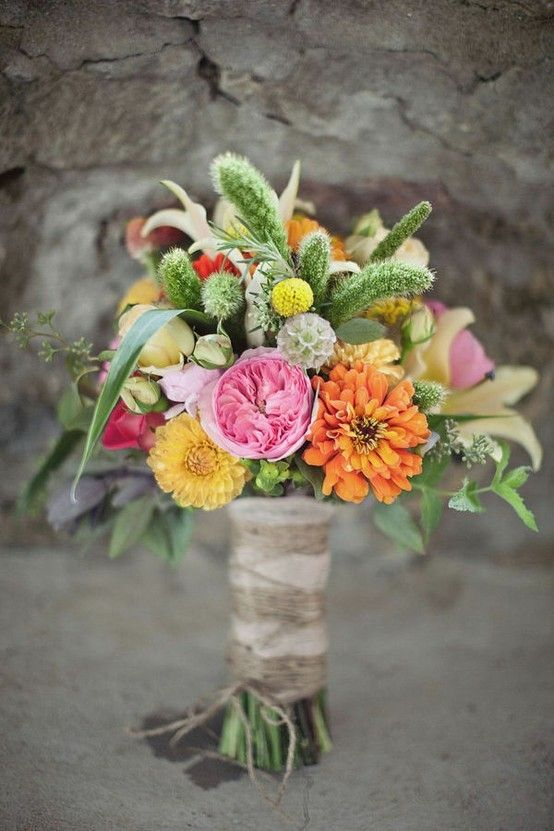 Lush summer bouquet featuring Garden Roses, Dahlias, Scabiosa Pods, fresh Millet, Craspedia Billy Balls, and Spray Roses.