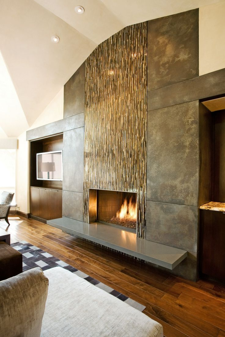 Fireplace wall flush wall with glass tile and metal panels with special patina floating hearth - Fire place walls ...