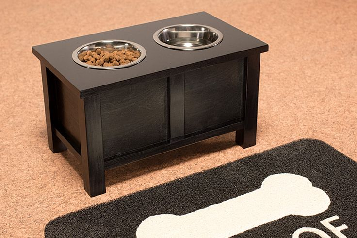 Elevate your dog's dining experience with a raised stand for its food and water bowls. The stand holds two 6