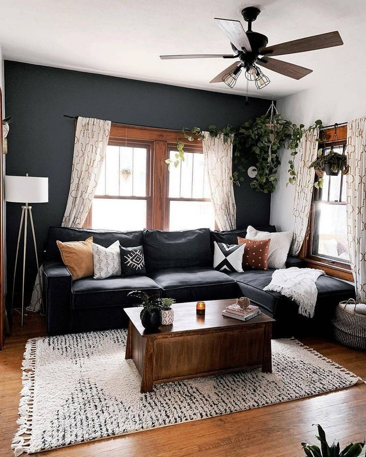 Bohemian Style Home Decors with Latest Designs  Living room design with a dark accent wall.