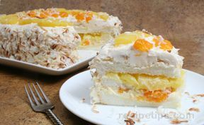 Ambrosia Cake -- An Angel Food Cake with lots of fresh flavor. The Pineapple, Mandarin Oranges, and Toasted Coconut give this cake recipe a Tropical Flair.