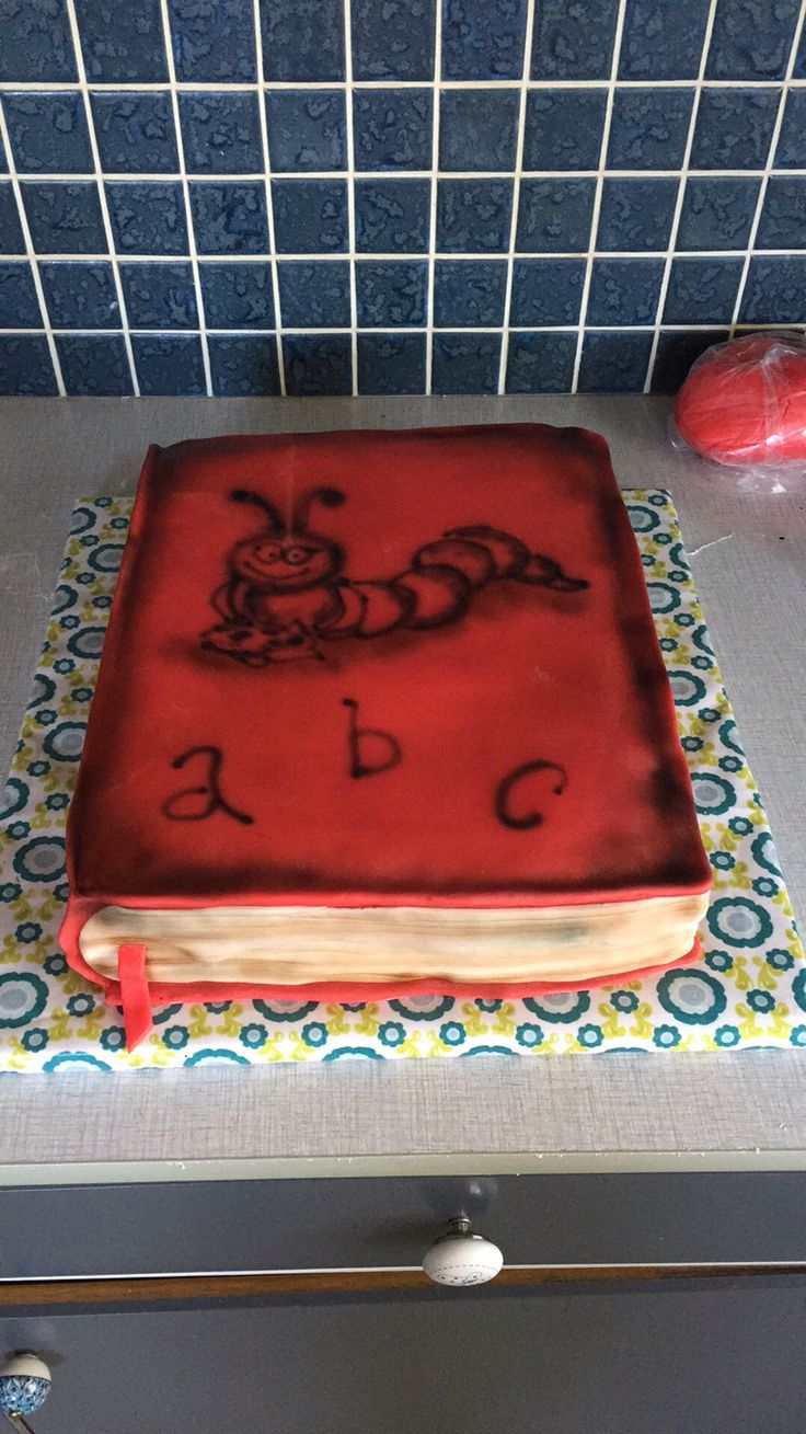Book cake with an airbrushed bookworm for my sons class. The cake was a prize for 'most Reading team'