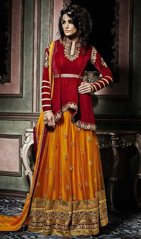 Make heads turn with this brick red color velvet lehenga choli dress. The ethnic lace, stones and resham work over a dress adds a sign of elegance statement for look. #rajwadistylelehengacholi #jardosiworklehengacholie #womenlehengacholis