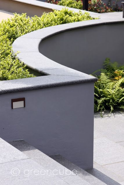 Grey rendered topped wall Subtle hard landscaping which can compliment surrounding planting.