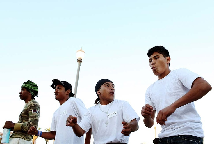 LOS ANGELES — LOS ANGELES, CA - JUNE 25, 2010: Jarlin Leonel Hernandez, second from left, Marlon Alexander Lux Bal, second from right, and Melvin Alexander Lopez, right, dance to a band performing at a concert in Mariachi Plaza. (Katie Falkenberg / For The Times)