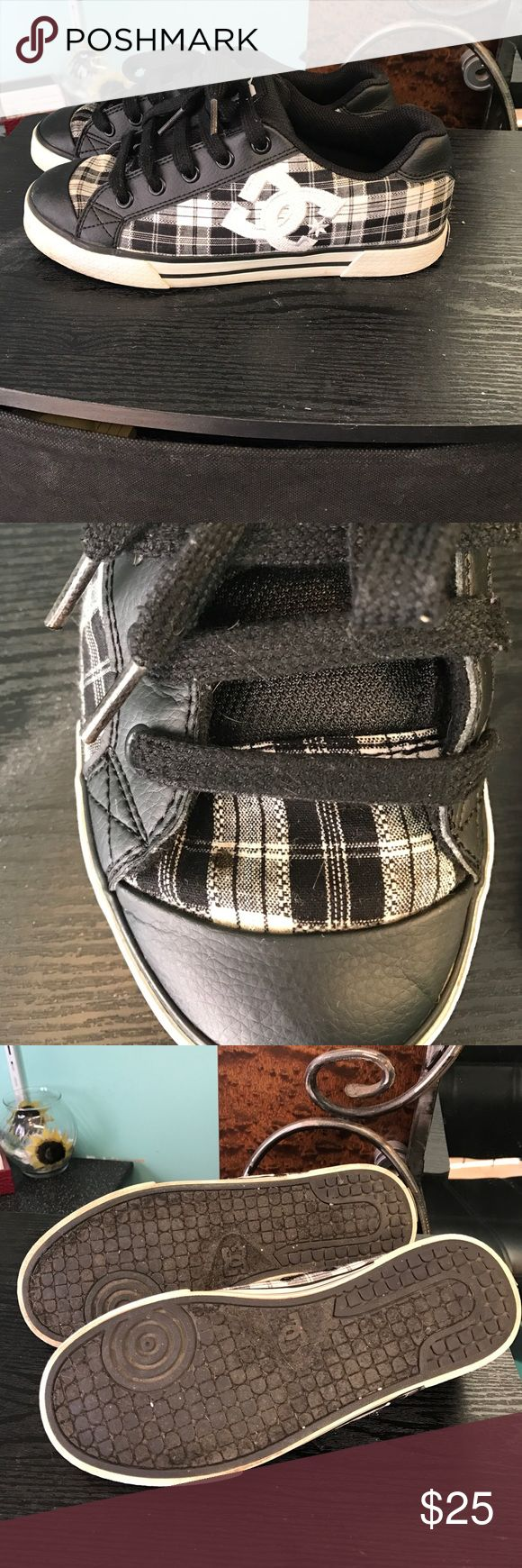 D.C. low tops Black and white plaid with silver metallic running through them. There is a spot on the top of the right shoe but, not noticeable when wearing them. Price reflected. DC Shoes Sneakers