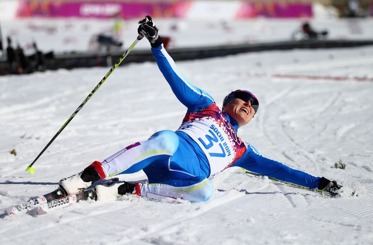 Aino-Kaisa Saarinen of Finland reacts after crossing the finish line during the Ladies' 10km Classic Cross-Country (c) Getty Images